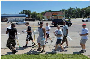 Ferguson citizens clean up after looting.
