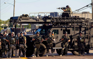 "Militarized police in Ferguson giving no impression of ""serving and protecting"" the community."