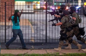 Militarized police harass an unarmed citizen.